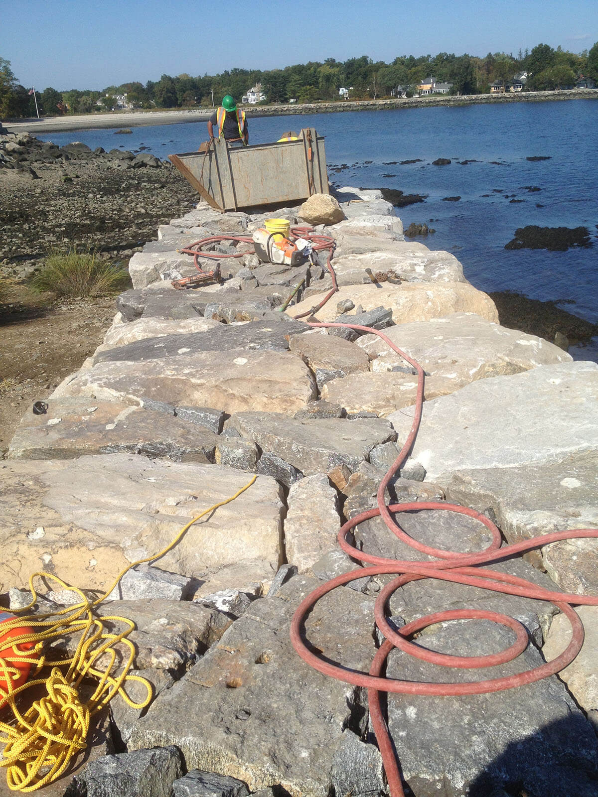 Rebuild of Large stone groin running parallel to shoreline-Seawall for protection